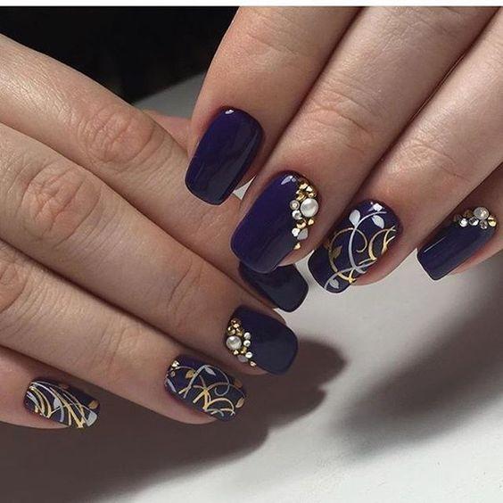 Christmas blue manicure with rhinestones