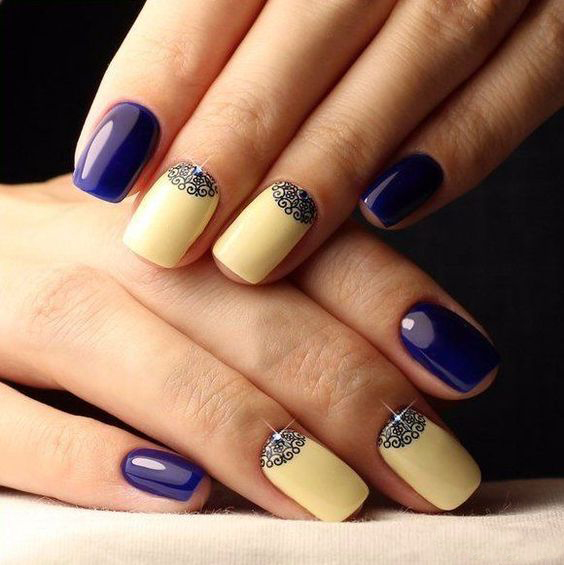 blue manicure with snowflakes and rhinestones