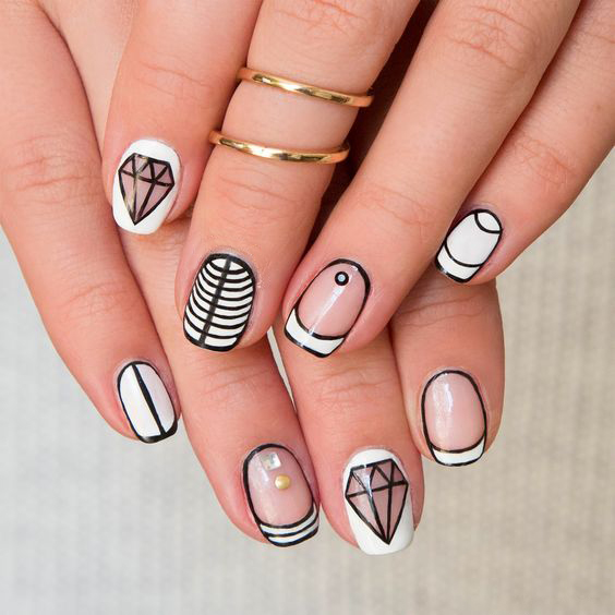 unusual beautiful drawings on the nails photo