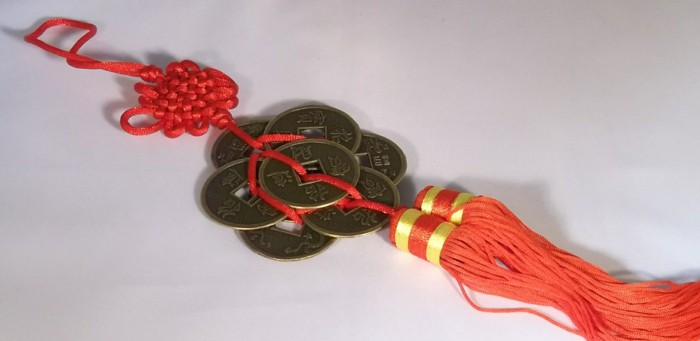 Chinese red ribbon money strengthens wealth sector