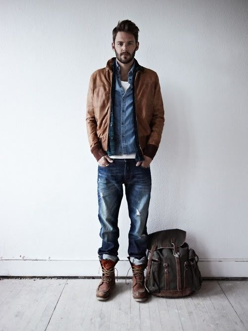 denim shirt combined with a jacket and a backpack
