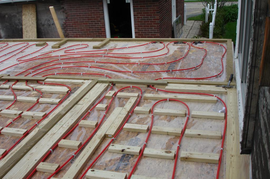 Installation of wooden floor heating