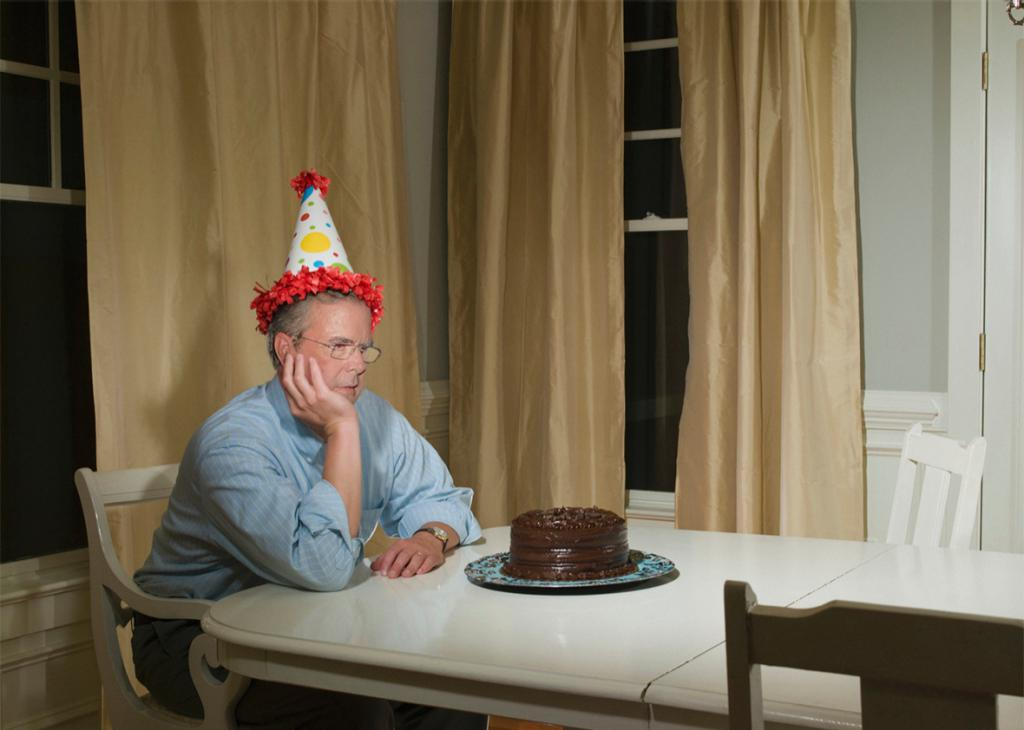 Man in front of cake