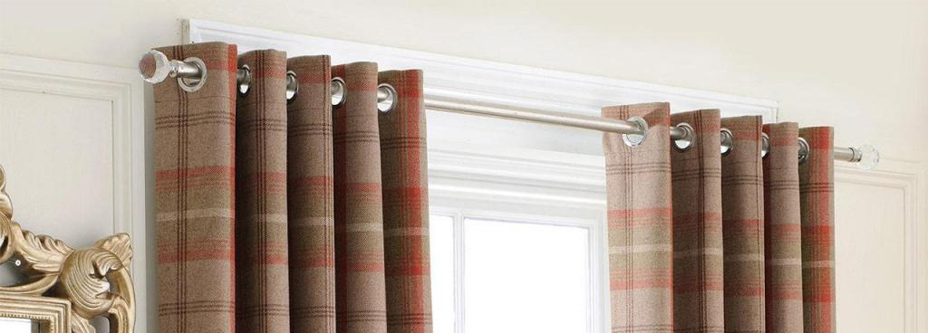How to hang a curtain rod on a wall