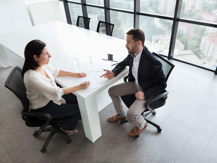 A man communicates with a woman