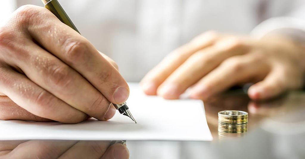 A man writes something on paper
