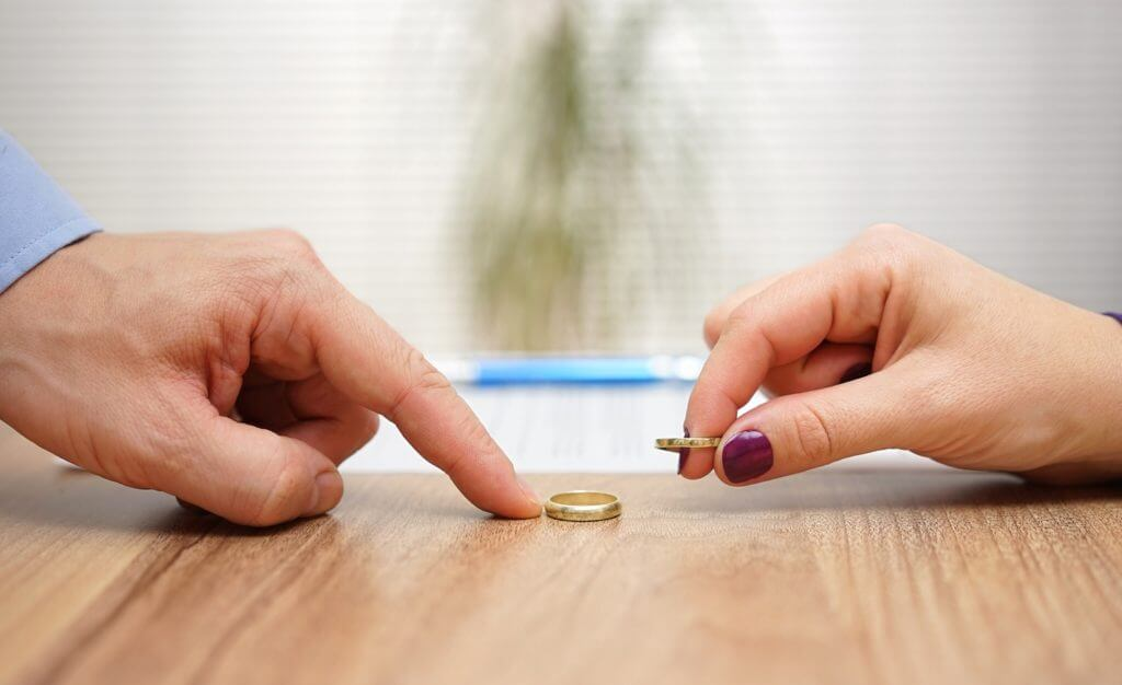 Man and woman return rings