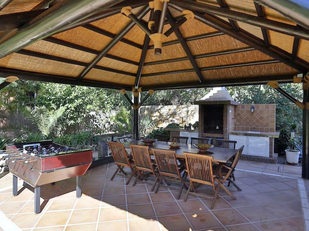 Gazebo with barbecue and smokehouse