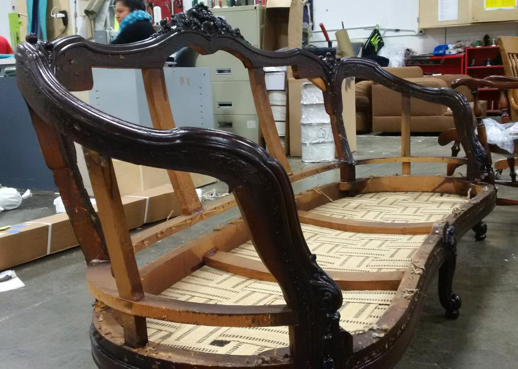 Restoration of wooden surfaces of a sofa