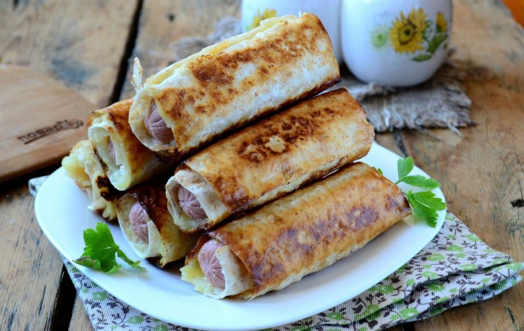 Sausages with cheese and mashed potatoes in pita bread