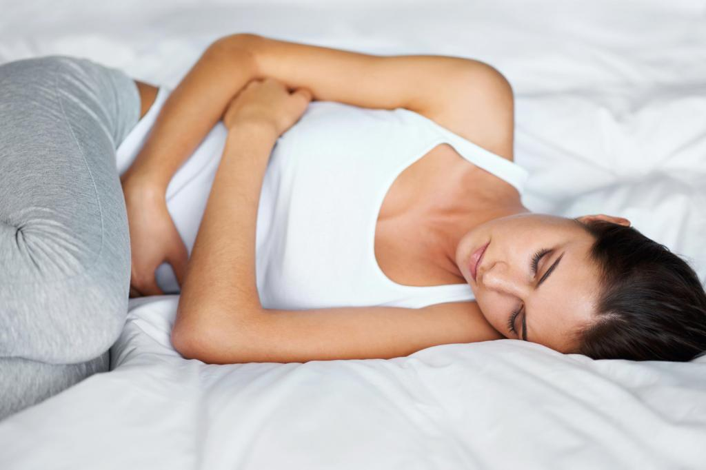 Болит живот во время менструации