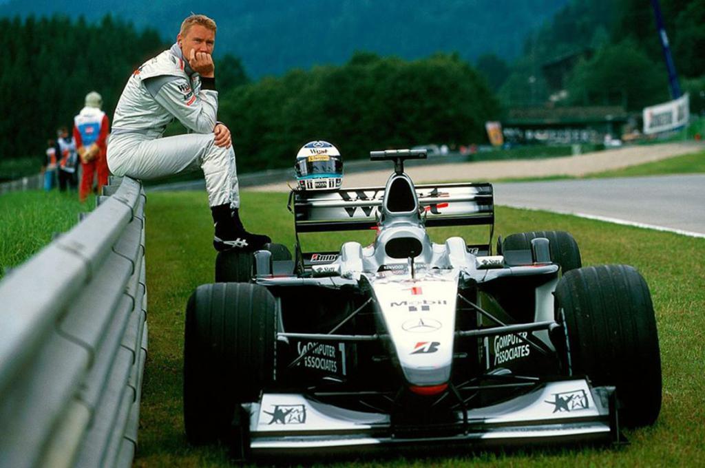 Hakkinen with his car.
