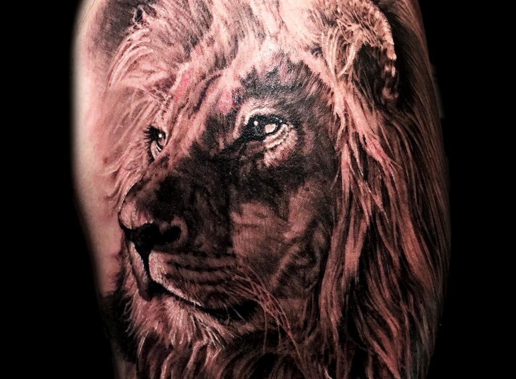 Тату со львом: мистика и символика