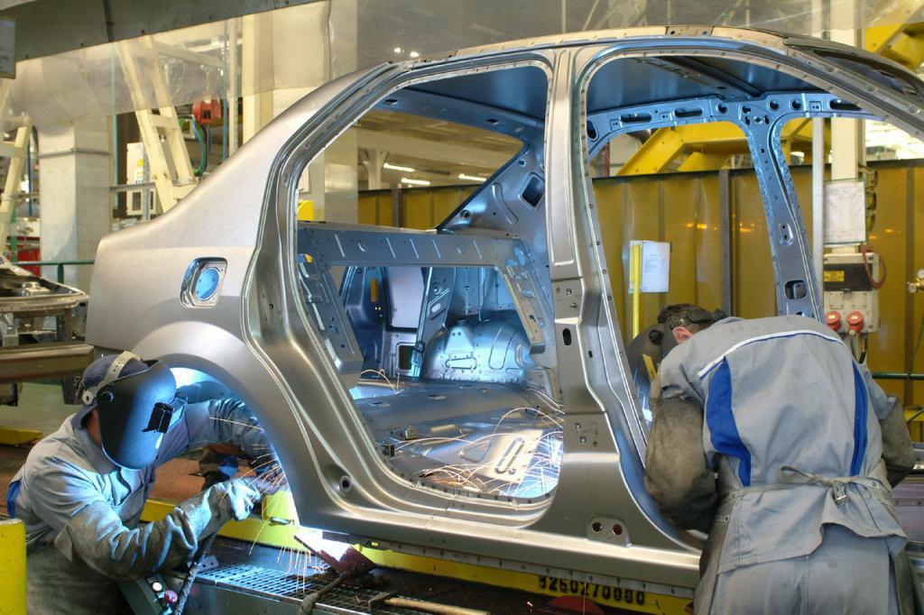 Assembling a car at the factory