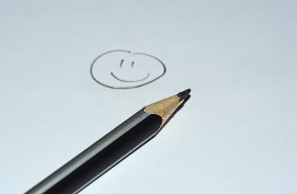 Drawn emoticon on paper.