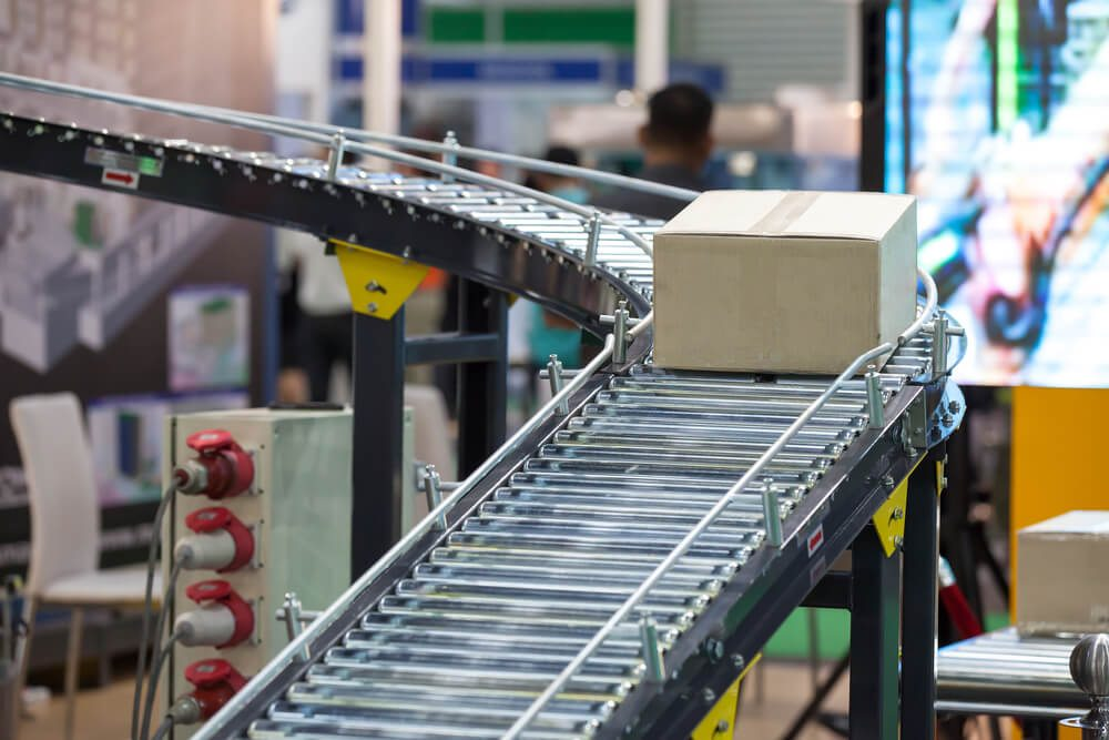 The box goes down the conveyor.
