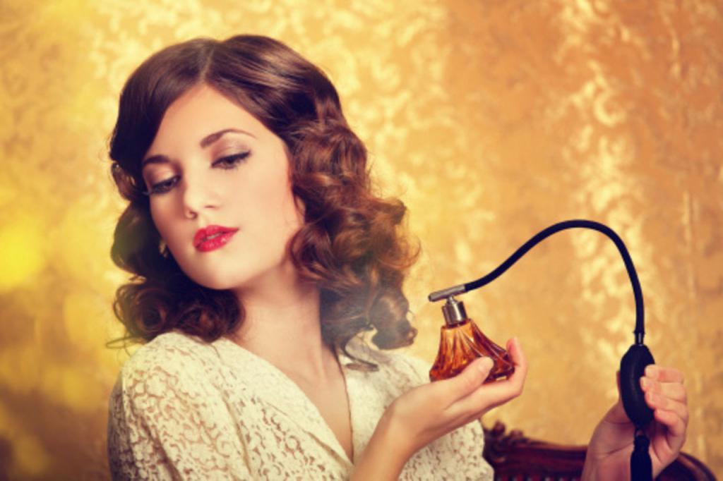 Girl applies perfume