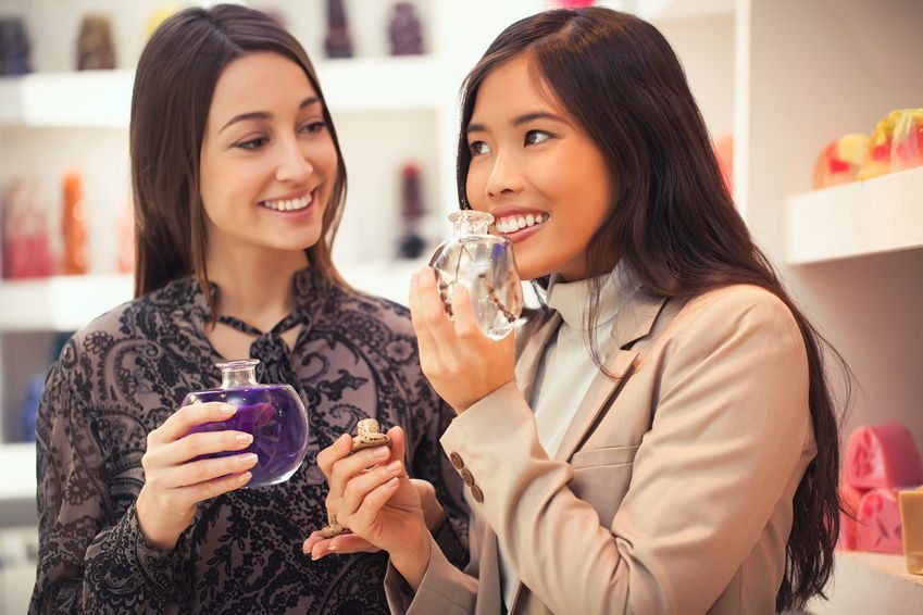 Girls choose perfume in the store